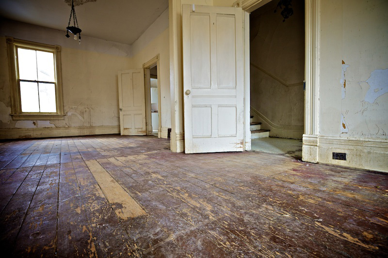 Living room and dining room of derelict house