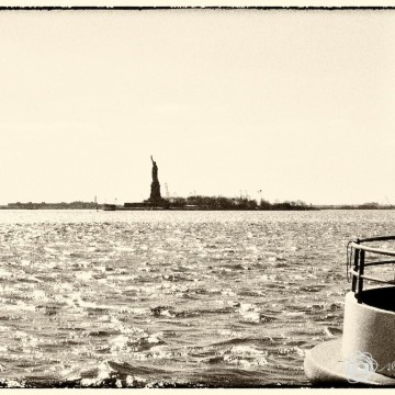 Statue of Liberty and Hudson River seen from Battery Park, New York